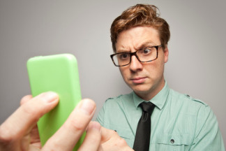 Is Your Site Mobile Friendly - Man Looking at Phone